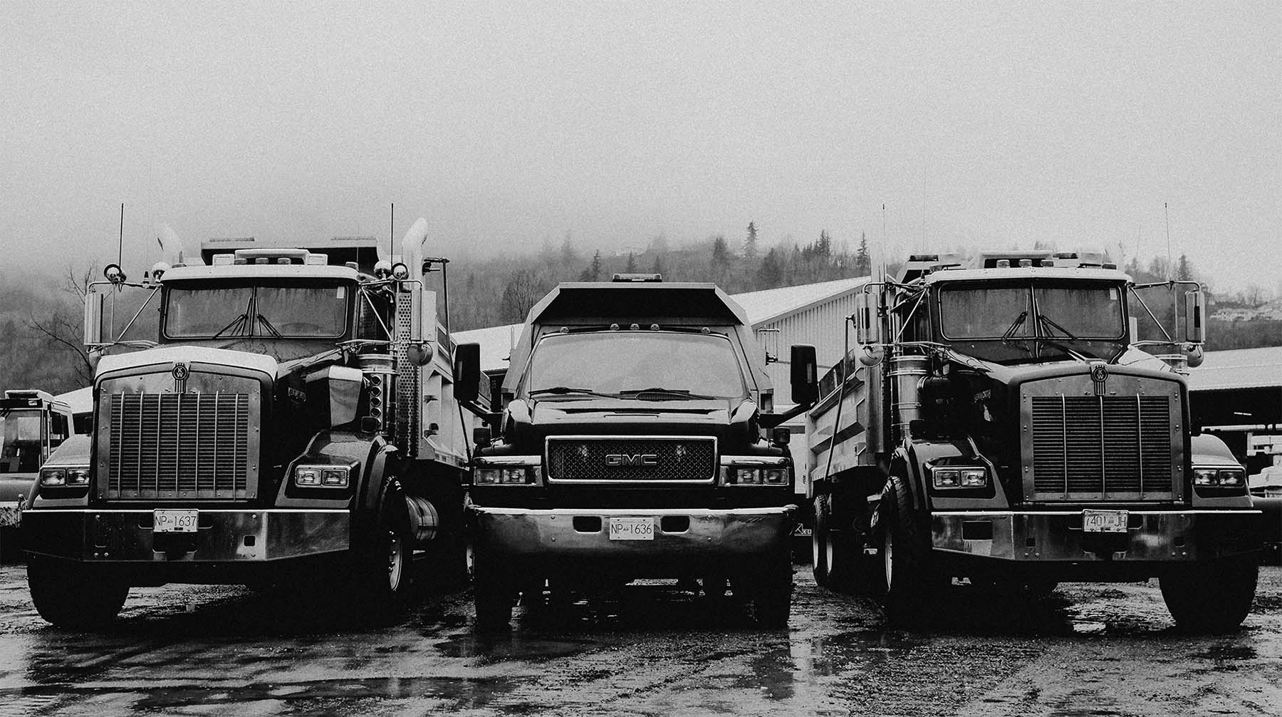 Strohmaier Excavating trucks parked in their lot in Chilliwack, BC